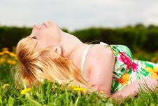 Free Beautiful Girl Lying Down Of Grass Royalty Free Stock Photos - 14338918