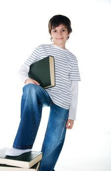 Little Boy Near The Stack Of Big Books Royalty Free Stock Photo