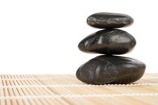 Some Dark Stones Lie On Mat Isolated Royalty Free Stock Images
