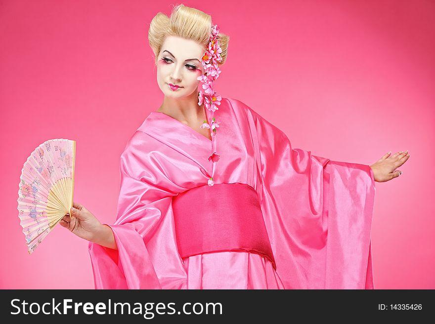 geisha dancing with a fan