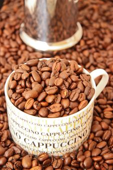 Free Coffee Beans In A Cappuccino Cup Royalty Free Stock Photos - 14340188