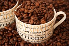 Free Coffee Beans In A Cappuccino Cup Royalty Free Stock Photos - 14340378