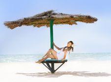 Happy Girl Relaxing On Beach Stock Photo