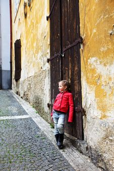 Free Girl Near The Old Wall And Door Royalty Free Stock Photography - 14341137