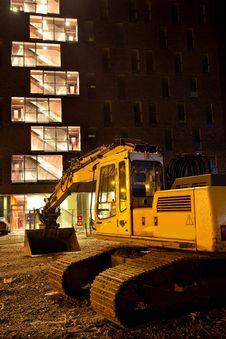 Excavator Crane In Front Of Building Stock Photo