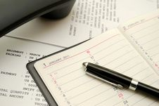 Free Phone With Capped Black Pen On Planner Stock Images - 14345364
