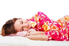 Free Sweet Young Girl In Pink Pajamas On Bed Stock Photography - 14348462