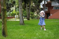 Free Adorable Toddler Girl Playing With A Grass Royalty Free Stock Photos - 14349138