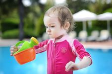 Free Cute Girl Playing In Swimming Pool Royalty Free Stock Image - 14349176