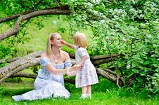 Mother And Daughter In Blooming Garden Royalty Free Stock Photos