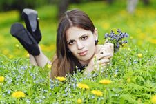 Free Girl Lying In A Grass With A Bunch Of Flowers Stock Photos - 14349923