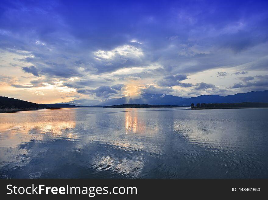 Sunset,sunrise Landscape,panorama.Beautiful Nature.Blue Sky,amazing colorful clouds.Natural Background.Artistic Wallpaper.Lake,sun