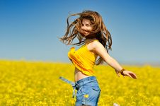 Young Woman On Blooming Rape Field Royalty Free Stock Photo