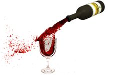 Wine Flowing From A Bottle In A Wine Glass Royalty Free Stock Photos