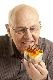 Free Senior Man Eating A Cake Royalty Free Stock Photography - 14353677