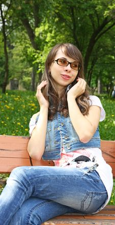 Attractive Girl Sitting On The Bench Stock Image