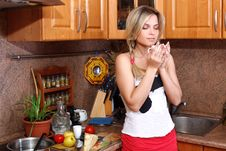 Free Woman With Hot Drink In The Kitchen Royalty Free Stock Photos - 14357468