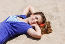Free Young Woman Laying On Sand Beach Stock Image - 14357501