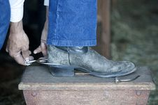 Free Putting On Spurs. Royalty Free Stock Photography - 14358937