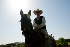 Free Cowboy Riding His Horse Stock Images - 14359214