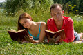 Free Couple Reading And Relaxing At The Park. Stock Photography - 14363212
