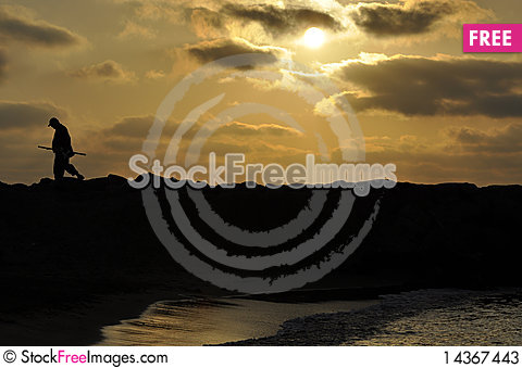 A fisherman at sunset time Stock Photo