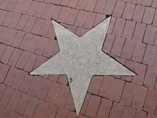 Free A Concrete Star In The Sidewalk Royalty Free Stock Photography - 14361027