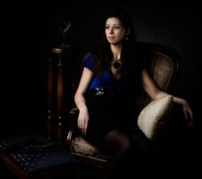 Free Portrait Of Woman Seated In A Chair Royalty Free Stock Images - 14362769
