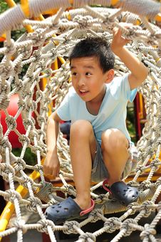 Free A Child Climbing A Jungle Gym. Stock Photography - 14363982