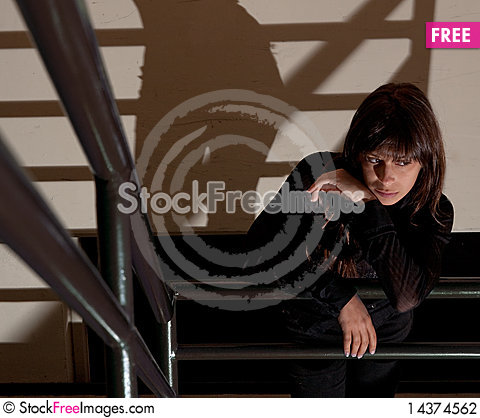 Woman Waiting in Stairwell Stock Photo