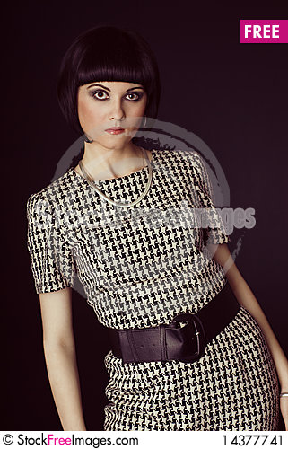 Girl in checked dress Stock Photo
