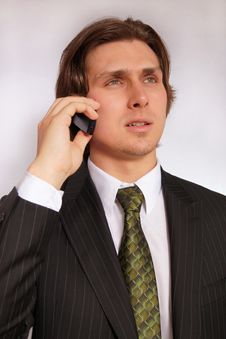 Free Young Businessman With Phone Stock Image - 14370741
