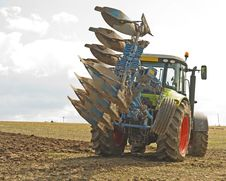 Tractor Turning With A Raised Plow. Royalty Free Stock Image