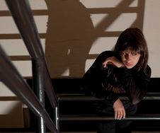 Woman Waiting In Stairwell Stock Photography