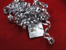 Silver Ribbon And Tag On Red Textile Stock Photos