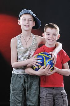 Two Laughing Boys With A Ball Stock Image