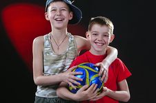 Two Laughing Boys With A Ball Royalty Free Stock Photos