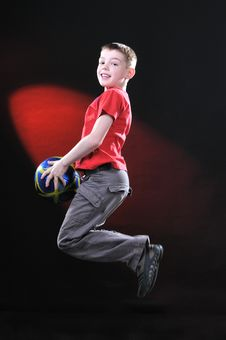 Free Boy In Jump Catches A Soccer Ball Stock Photography - 14376712