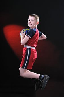 Free Boy In Jump Catches A Soccer Ball Stock Photo - 14376730