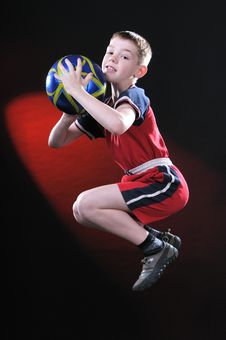 Free Boy In Jump Catches A Soccer Ball Royalty Free Stock Image - 14376746