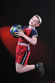 Free Boy In Jump Catches A Soccer Ball Stock Photos - 14376763