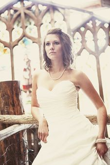 Free Young Pretty Bride In Front Of Stain Glass Royalty Free Stock Images - 14377329