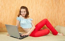 Girl  With Laptop On Sofa Stock Photography