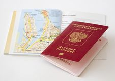 The Russian Passport Lies On A Map Of The City Royalty Free Stock Image