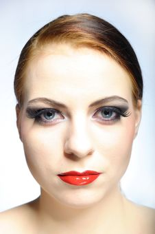Young Beauty Female Face With Red Shiny Lips