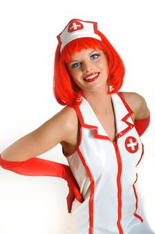 Beautiful Funny  Female Doctor With Red Hair Stock Photo