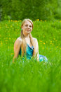 Free Blonde Girl Relaxing In Grass Stock Photography - 14383422