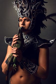 Pagan Priest In Ritual Suit With Green Iguana Stock Photos