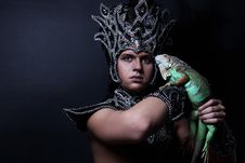Free Pagan Priest In Ritual Suit With Green Iguana Stock Photos - 14381153