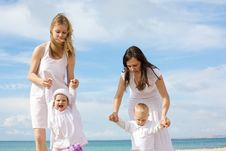 Happy Mothers With Children At The Beach Stock Image